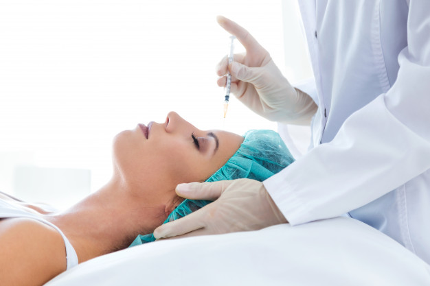 beautiful young woman getting botox cosmetic injection her face 1301 7795
